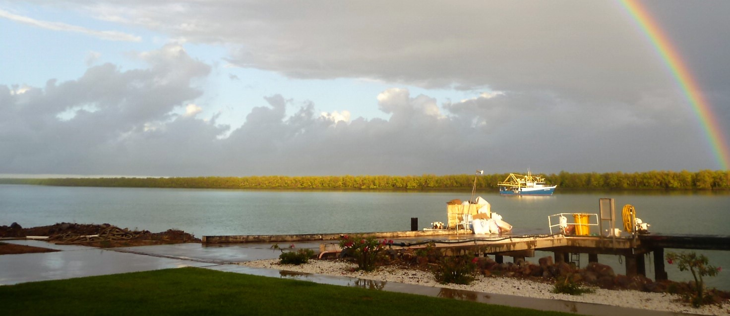 Early morning rainbow over Norman River, Karumba